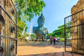 ULUWATU, BALI, INDONESIA - MARCH 26 : Tourist visit Lord Vishnu statue at the Garuda Wisnu Kencana Cultural Park on March 26, 2014 in Uluwatu, Bali, Indonesia.